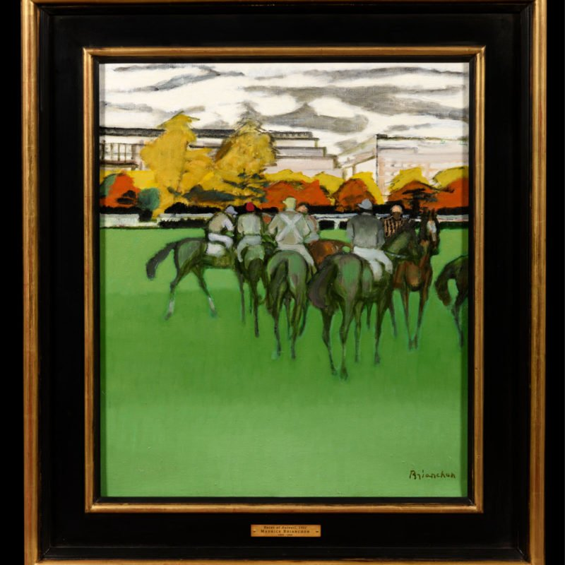 A group of racehorses gathered on a racetrack with autumnal trees in the background by Maurice Brianchon