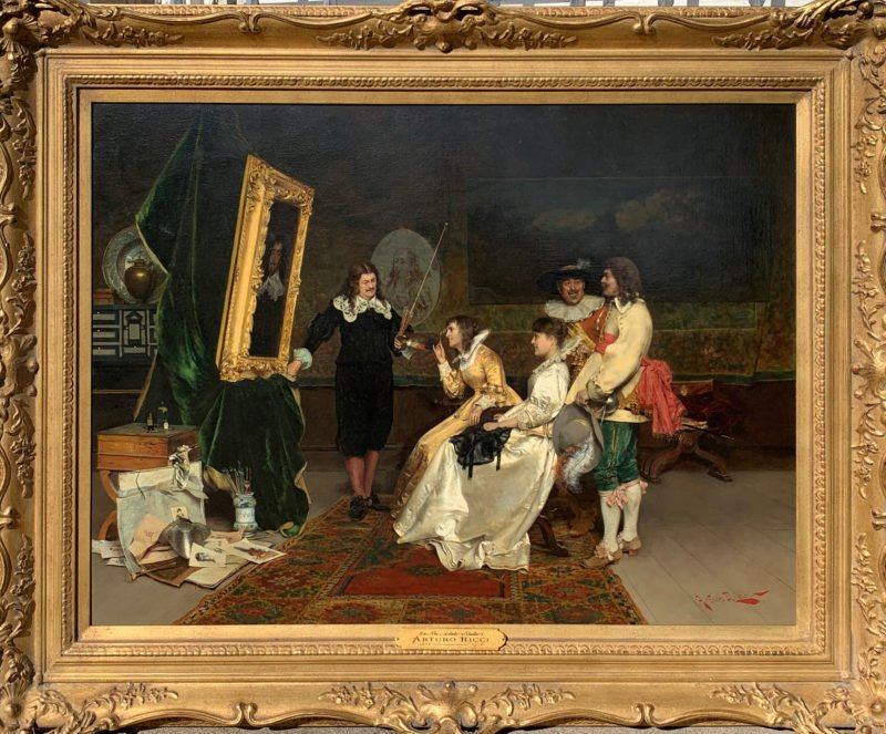 A portraitist stands by a frame whilst two women and two men look on by Arturo Ricci