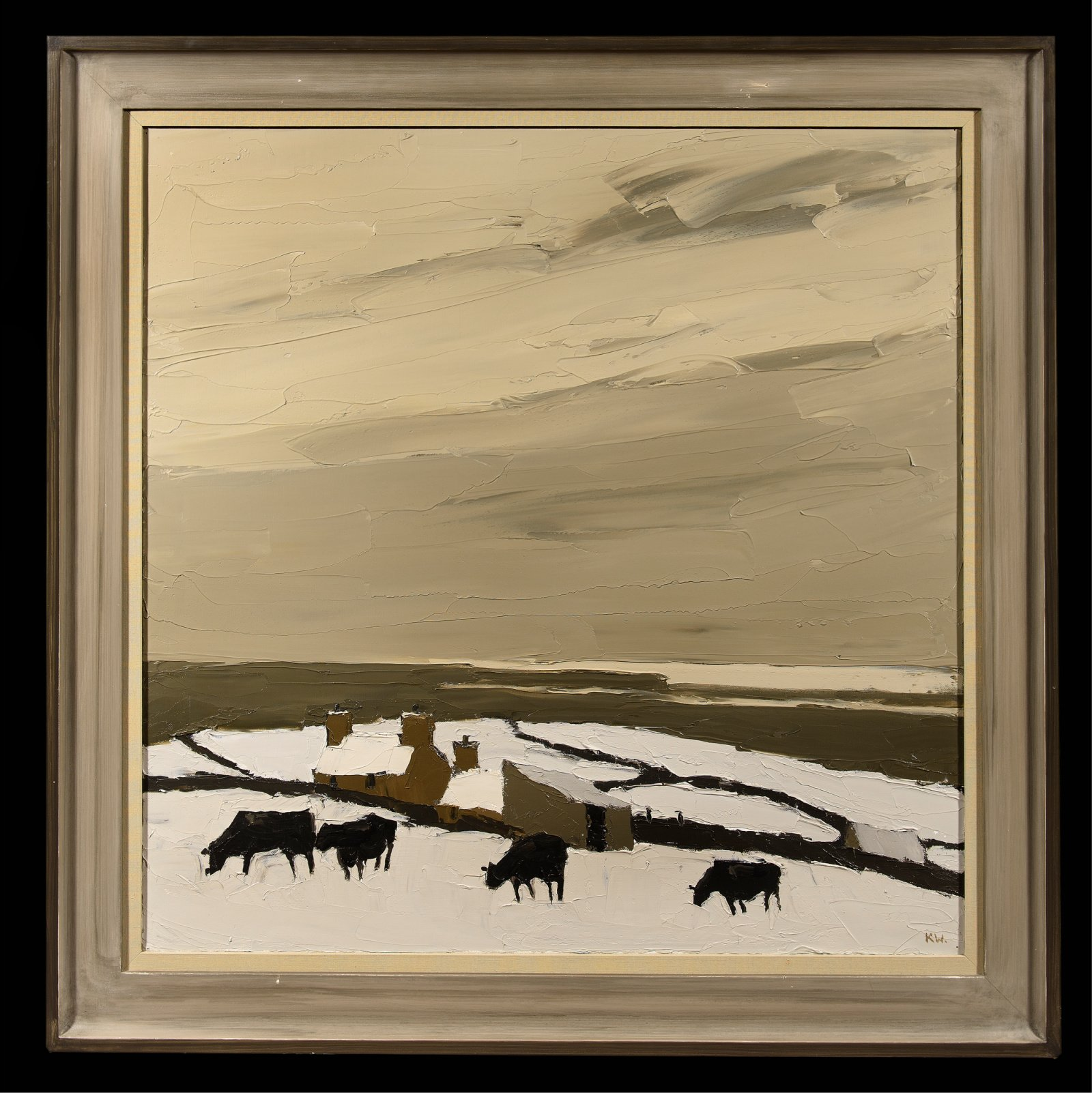 landscape of a hill covered in snow with cattle grazing on top and moody sky in the background