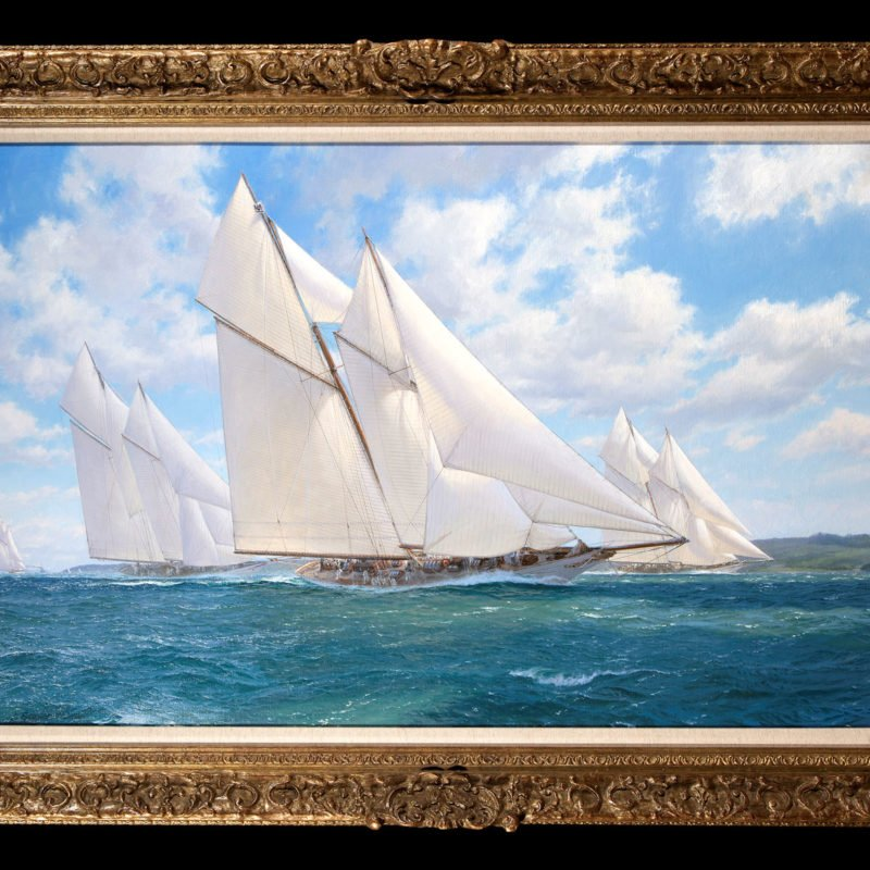 Three sailing ships on the sea with blue sky