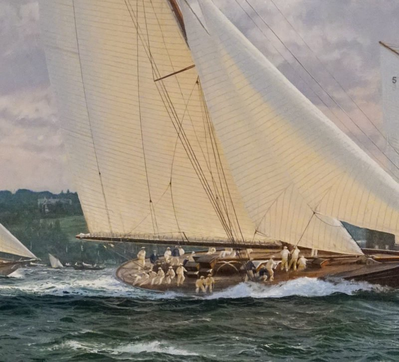 crew on a racing yacht with white sail