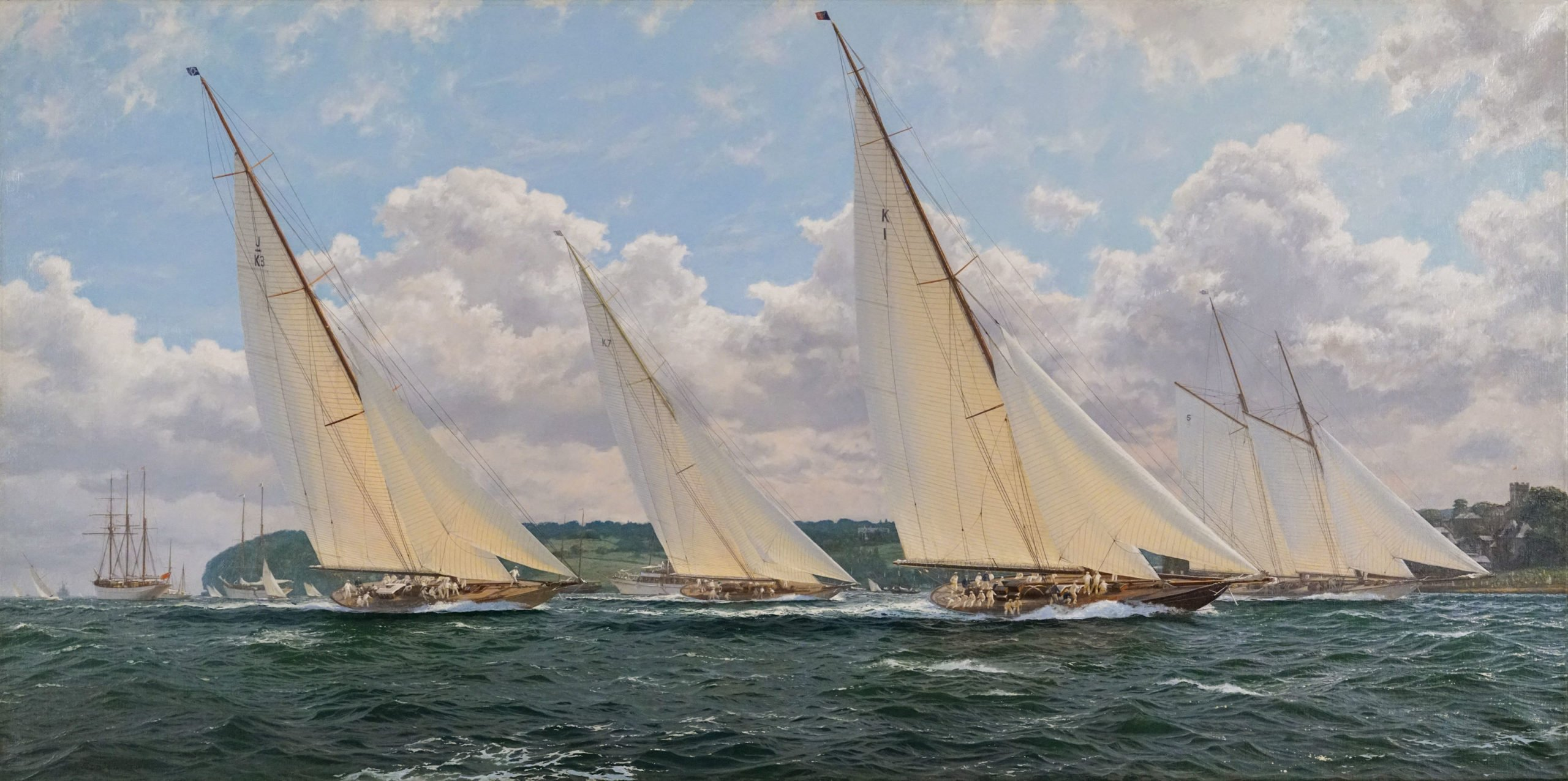 4 yachts with white sails with blue sky and clouds